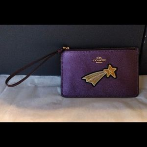 NWT Coach raspberry wristlet with gold star
